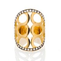 Precision-crafted KATI ring, featuring a geometric motif and brilliant cut Diamonds in an 18 karat yellow Gold setting. By Kathaline Page-Guth.