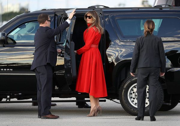 Melania Trump Photos Photos - President Donald Trump's wife Melania Trump prepares to get into a vehicle after arriving on Air Force One at the Palm Beach International Airport to spend part of the weekend at Mar-a-Lago resort on March 17, 2017 in West Palm Beach, Florida. President Trump has made numerous trips to his Florida home since the inauguration. - President Trump Arrives In Florida For Weekend At Mar-A-Lago Estate