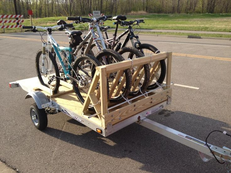 """One solution for 4 bikes on a small car. """"Trailer is a Triton XTV (~200lb) and the wooden bike rack is homemade. Towed it ~1500 miles this spring and it was solid."""""""