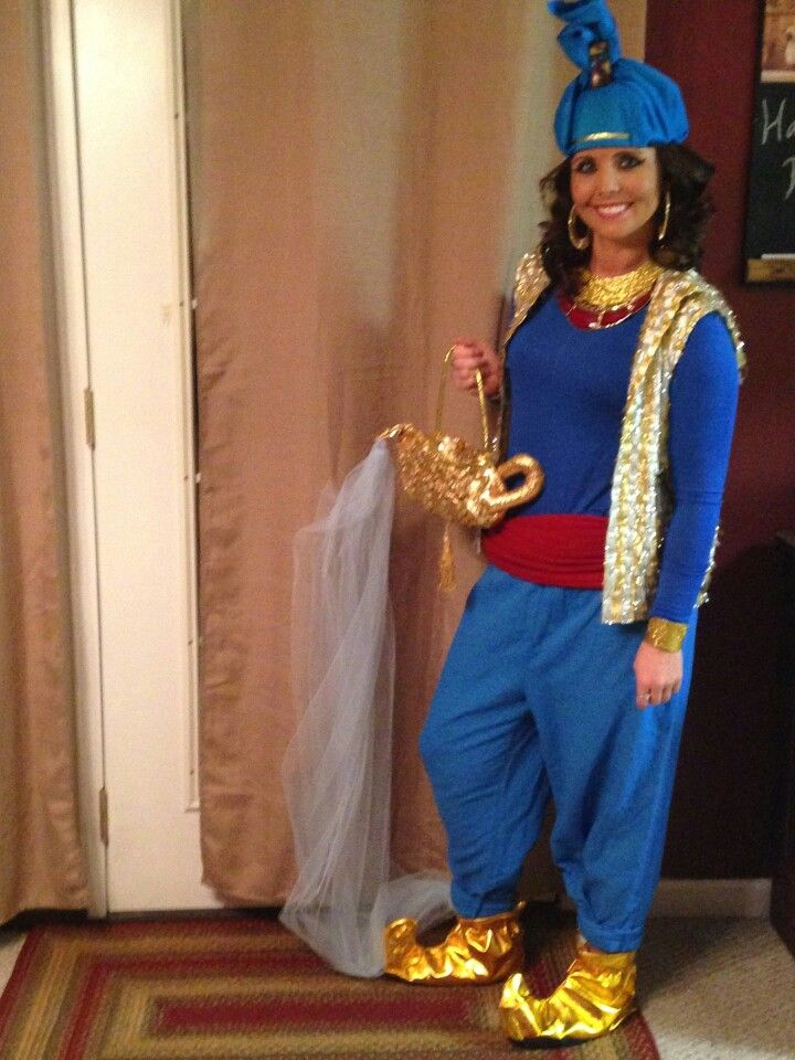 Aladdin Genie Costume DIY...large pants pegged at bottom, blue fitted long sleeve shirt, red scarf,thrift shop shimmery vest, costume jewelry (if not in gold, use glue n glitter), amazon.com for shoes & lamp purse, thrift shop wiseman's cap and brouche for turban,(or order from amazon) and don't forget tool fabric for your genie smoke :)