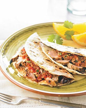 Mojo Marinated Pork Tacos--Mojo  is a zippy Cuban marinade usually made with citrus, garlic, and other spices. Serve with Grilled Salsa Roja