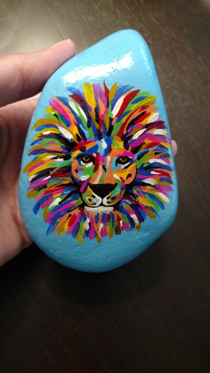 A florescent painted lion rock. Rock art. Painted rock. @RocksByMisty #RocksByMisty
