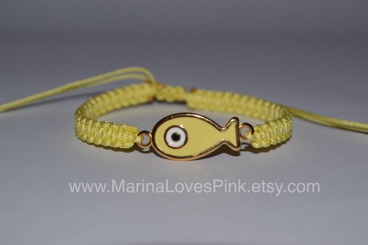 A personal favourite from my Etsy shop https://www.etsy.com/listing/539548679/evil-eye-fish-macrame-bracelet-pastel