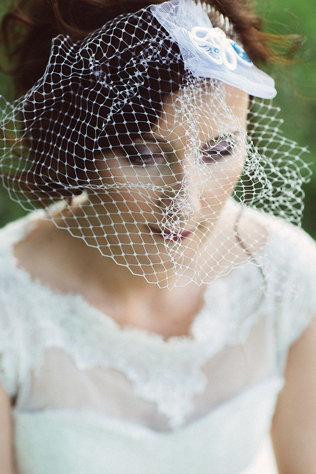 Decoration on the comb was made in the technique braid, with the addition of stunning Swarovski crystals, pearls Seashell and snow-white veil and tulle.
