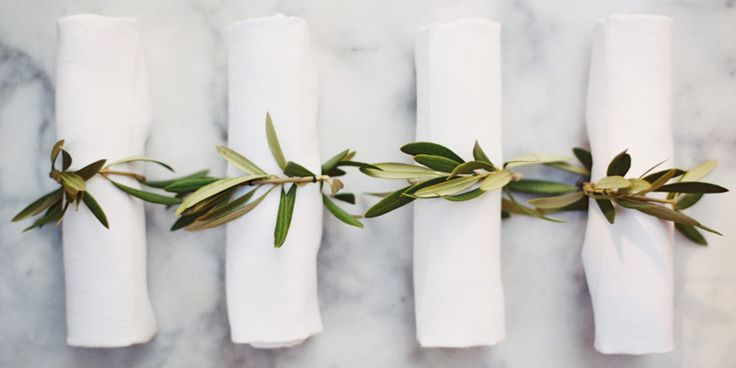 It's a simple touch, a eucalyptus napkin ring, but the chic simplicity and attention to detail will wow your guests.   - HarpersBAZAAR.com
