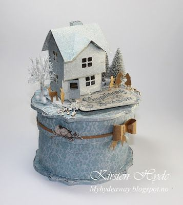 A box with a glitter house / put house. The Christmas scene is created with papers from Maja's new collection Home for Christmas. Template for the glitter house and for the oval box in the blog.