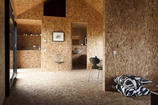 OSB plywood used as interior sheathing on floor, walls, and ceiling.