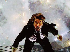 "1988 - Alan Rickman as Hans Gruber in ""Die Hard."" Rickman was dropped 40 feet for this shot, so the fear was very much real."