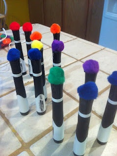 I Love My Classroom: pom poms glued onto the top of dry erase markers - instant eraser