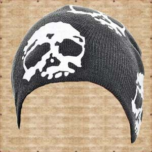 A black skull beanie with large white skulls. The Beanie With Large White Skulls by Queen of Darkness in the Skulls and Dragons accessories range.    Weight : 20.00g    Made from cotton    Ref : SDACP04407   Price : 6.99 GBP