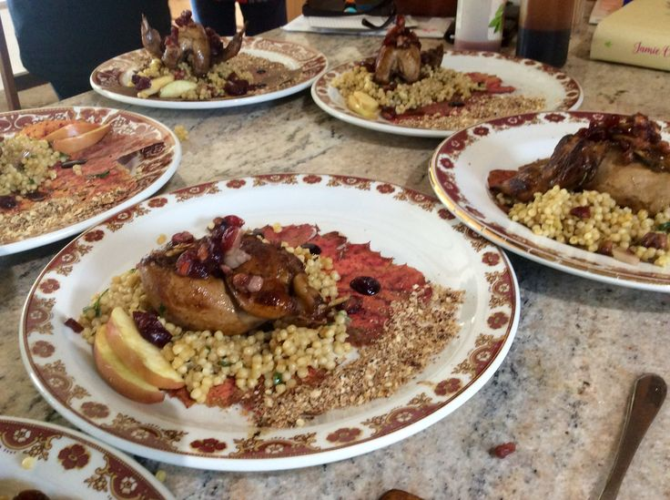 Stuffed Autumn quail on couscous with pomegranate molasses and hazelnut crumb