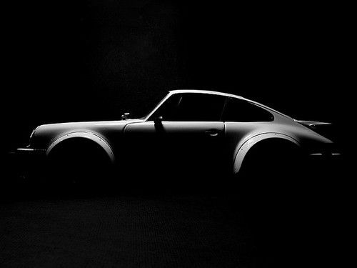 The shape and curves of the car are brought out with the use of light in the upper left corner. The style of photography added with the use of black and white suggests that the photographer was aiming for a classic/historical feel