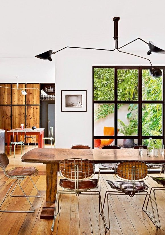 Awesome dining space with a glimpses of outdoors through the window and of kitchen at the rear.