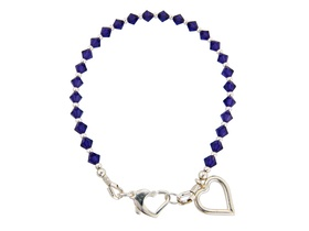 friendship bracelet with silver heart charm £30