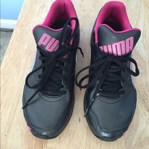 Puma tennis shoes Cute pink and black tennis shoes! Worn only a couple times ! Size 8, fits kinda tight so they need to be broken in. Puma Shoes Athletic Shoes