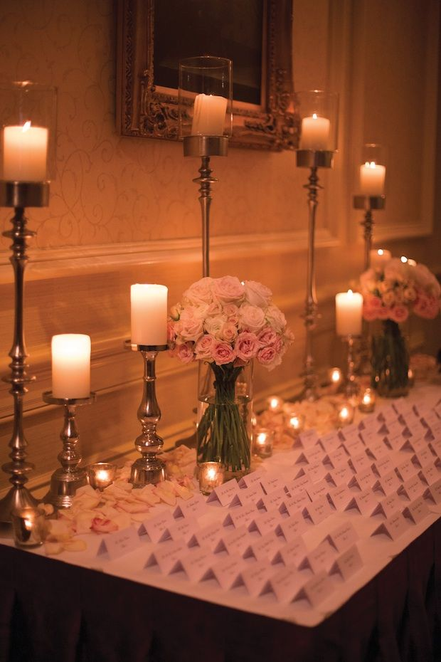 Beautiful Blooms - Mixed Candlelight, Petals, and Flowers Lining the Back of the Escort Card Table