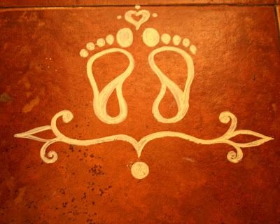 it is customary to paint Krishna's footprints right from the entrance of the house to the prayer room, symbolising the arrival of Krishna.
