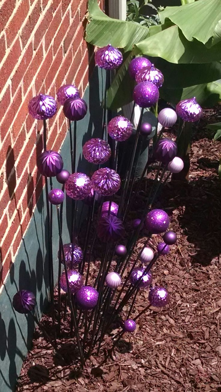 Making these from old Christmas ornaments & garden stakes. My fake allium!