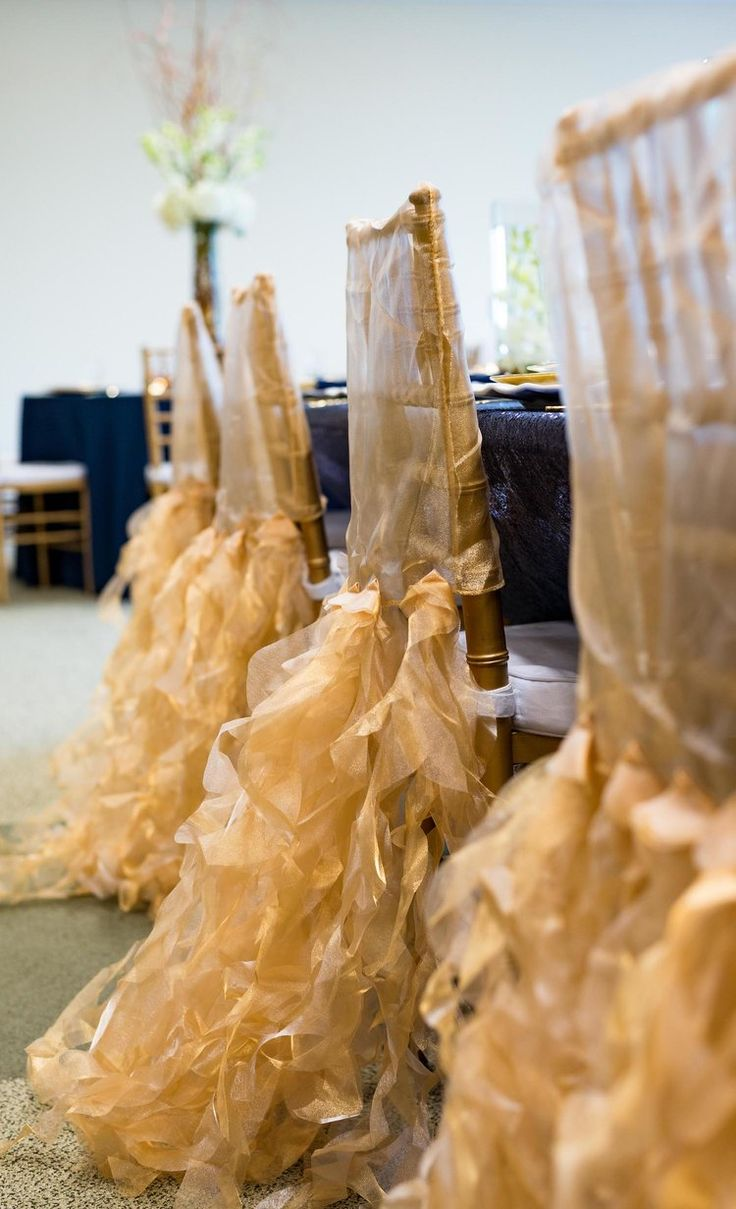 Stunning Ruffled Sheer Gold Chair Covers for an elegant and modern style wedding / designed by Monika Michelle Events / North Carolina Weddings and Events Planner / see more on www.BrendasWeddingBlog.com
