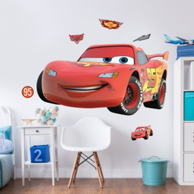 Bring the magic of Disney to their room with this large sticker kit! A unique alternative to bedroom accessories, the pack contains a large Cars wall sticker as well as a light switch sticker and door sticker. Simply peel and stick to decorate.