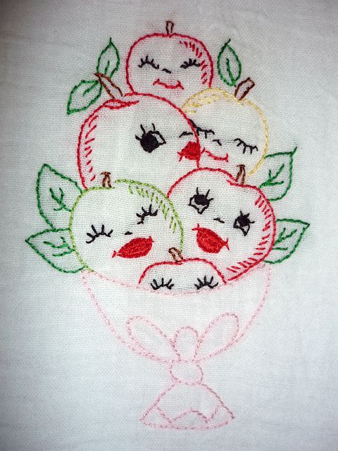 embroidered fruit with faces