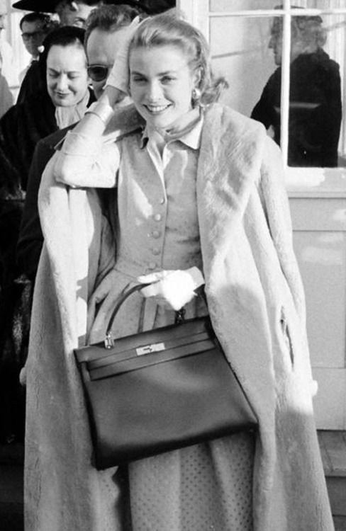 1950s Grace Kelly pictured with her Hermes bag.