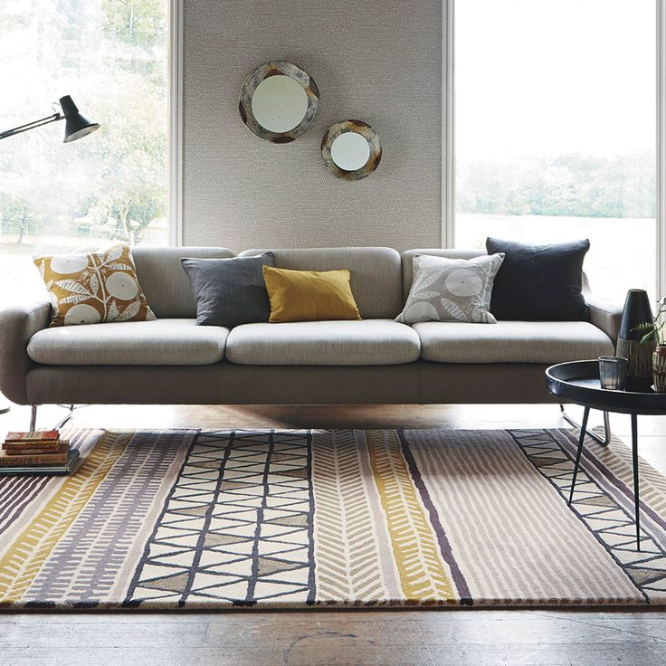 Scion Raita Rugs in Taupe feature a clever mix of graphic designs and an assortment of grey and green colours that are designed to suit the modern home