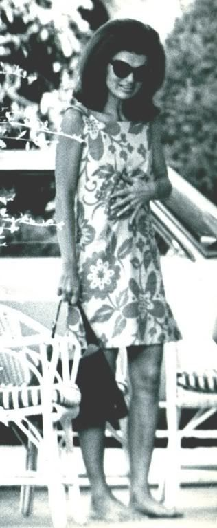 Rare photo of Jackie Onassis wearing a Pucci dress.