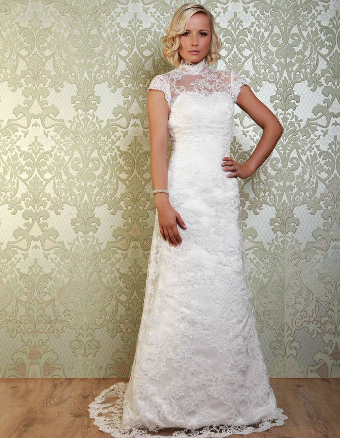 OBERON The gown is overlayed with lace and the simple, straight skirt sweeps down into a full train, complete with a scallop edge. https://www.wed2b.co.uk/vintage-wedding-dresses/viva-bride-oberon.php