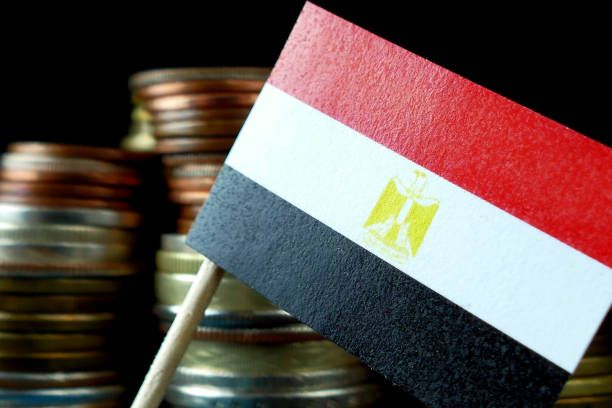 egyptian flag waving with stack of money coins macro