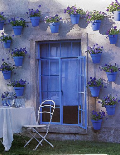 Blue Pots with Pansies   Adorable. I would do in Green Pots with pretty greenery and white flowers in them. (match my house/yard) Would be very pretty way to bring some life to an old shed wall .: