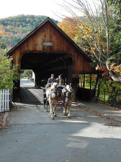"""Covered bridge, Woodstock VT - 10-13"" by Jessica Cato on Flickr ~ This is a covered bridge in Woodstock, Vermont...with the horse-drawn wagon it looks like a Currier and Ives painting."