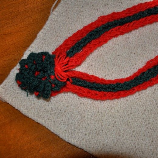 Finger knit cord necklace with crochet wreath