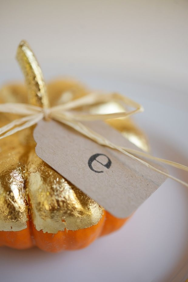Love this place setting idea! Gold topped mini pumpkins tied with gold ribbon and the initials of your guest. Easy peasy!
