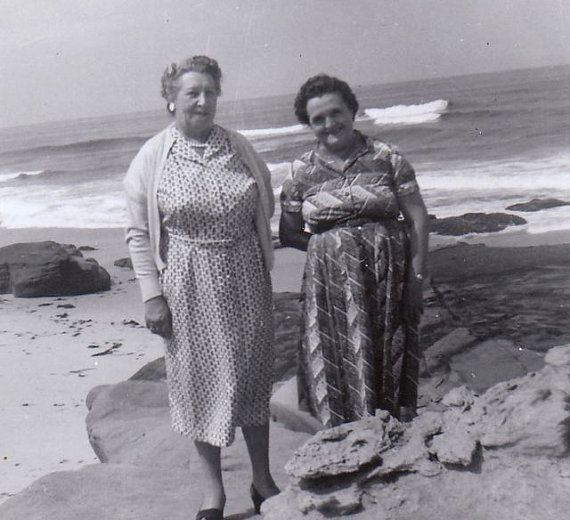 Ladies at the Beach 1940s Vintage Photograph. I knew ladies who looked like that- and they wore those dresses even to the beach!