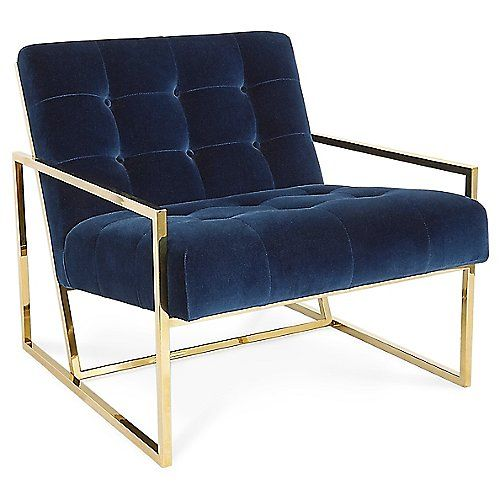 The Jonathan Adler Goldfinger Lounge Chair has a Mid-Century vibe that still pops in modern interiors. The pitched seat and button-tufted cushions give this minimal piece some detail while still being chic as well as adding some cushion. The polished brass legs and frame add contrast and a little drama with a bold border that is visible from behind.