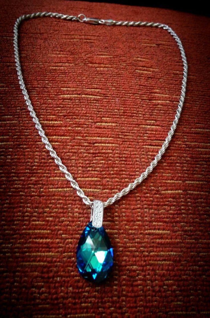 Cristal swaroski con plata y zicorne