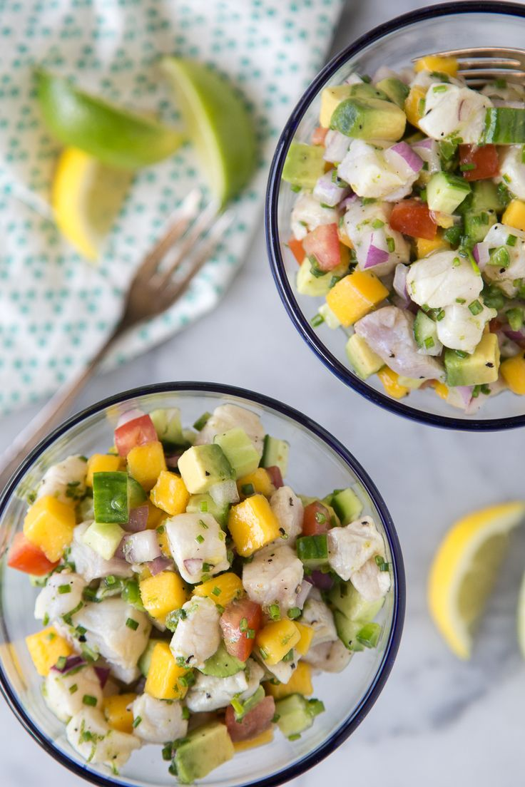 A tropical Sea Bass Ceviche made with mango, cucumber, avocado, tomato, red onion, chives and plenty of freshly squeezed citrus juice!