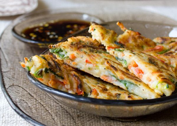 Crispy Korean Pancake Recipe, called Pajun (Pajeon) loaded with veggies and serves with a spicy soy dipping sauce. Korean Pancakse are easy to make and