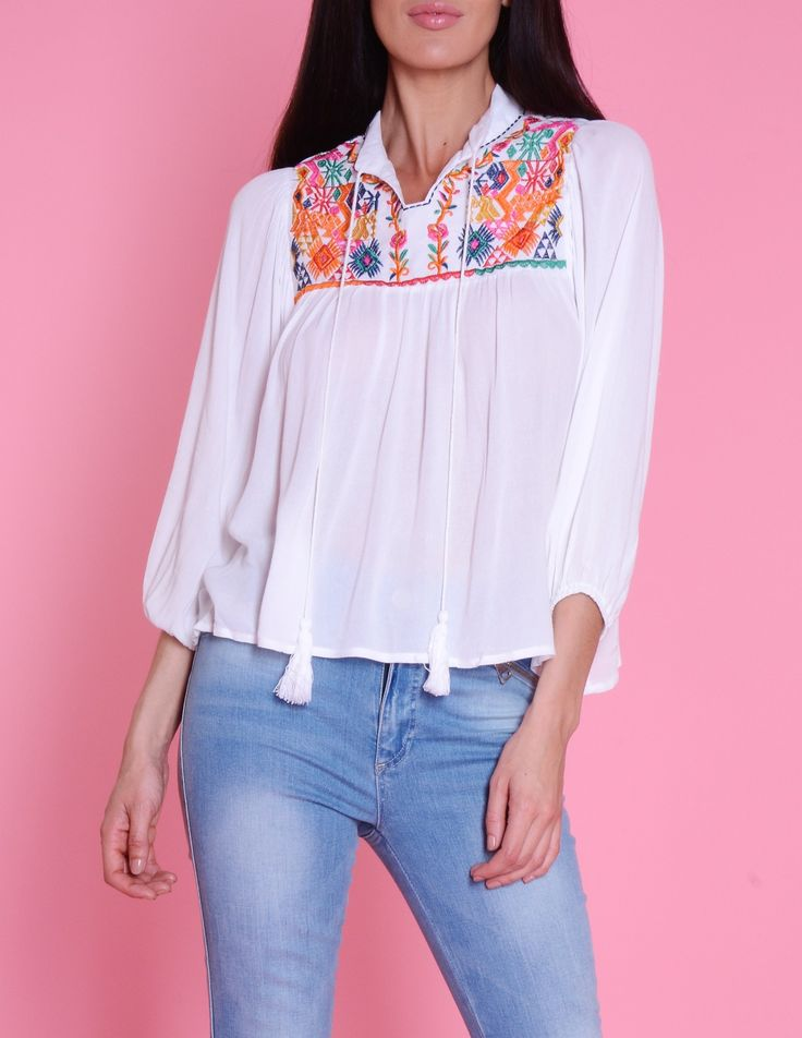 The Hope white chiffon floral top is a summer must-have. This oversized bohemian style top features long sleeves and a multi-coloured floral bib design to ensure you stand out in true seasonal style.