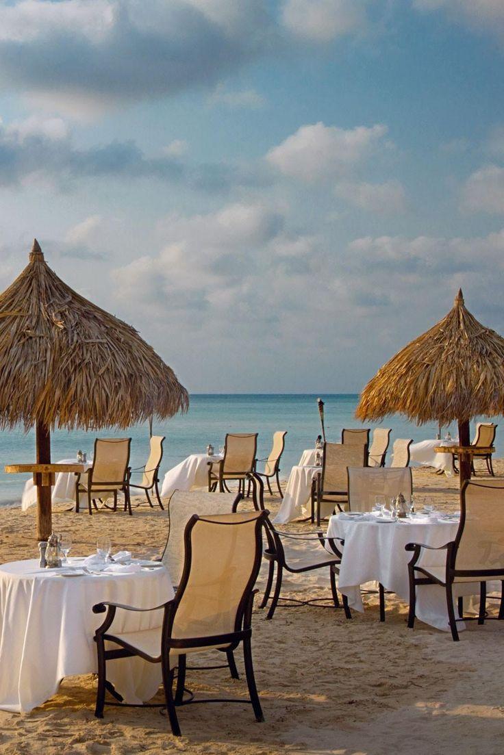 Book a table in the sand at romantic seafood restaurant Simply Fish. Aruba Marriott Resort & Stellaris Casino (Palm Beach, Aruba) - Jetsetter