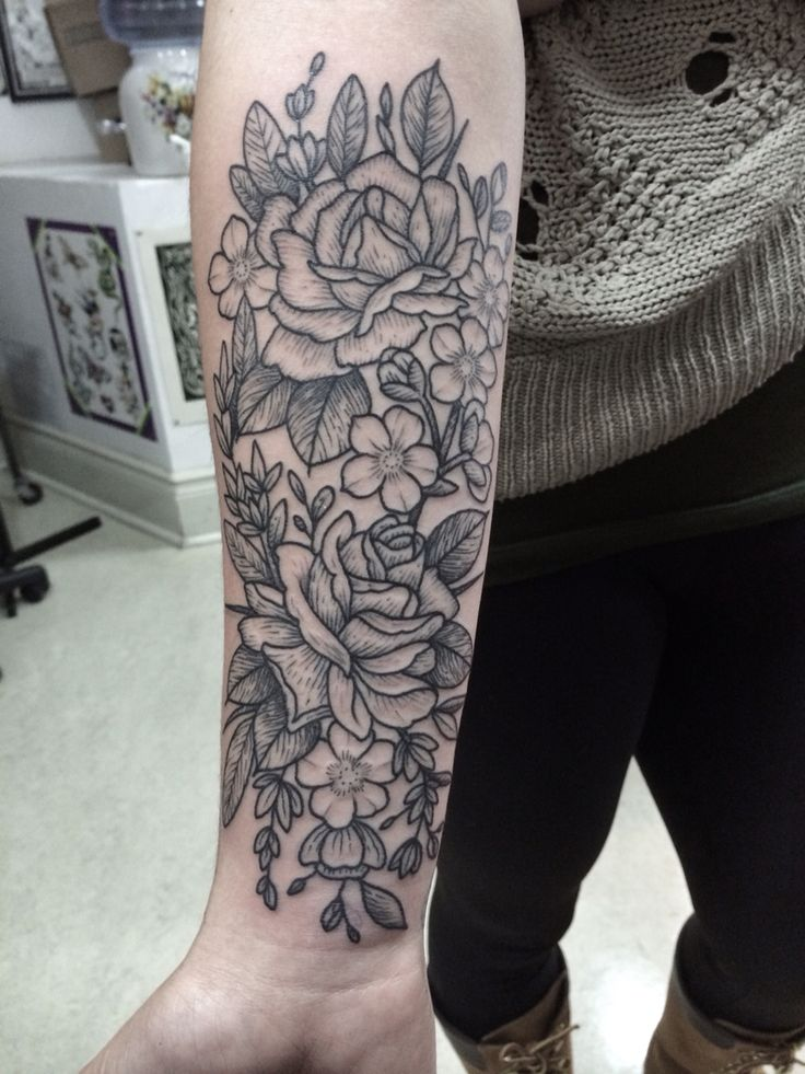 Roses and blossom tattoo. Woodcut. By Jennifer lawes.