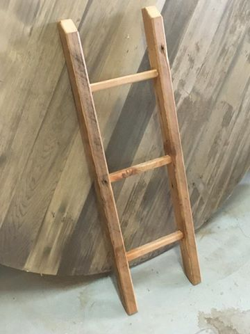 A step ladder in raw timber, only meant for decoration. Finished in a white wash and clear coat