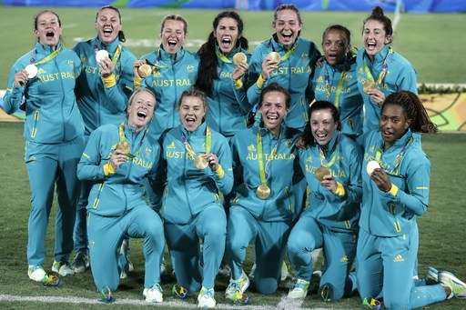 Australian women win 1st gold medal for Olympic rugby sevens  -  August 8, 2016  -      Australia's players celebrate after winning the women's rugby sevens gold medal match against New Zealand at the Summer Olympics in Rio de Janeiro, Brazil, Monday, Aug. 8, 2016. (AP Photo/Themba Hadebe)  -  August 8, 2016