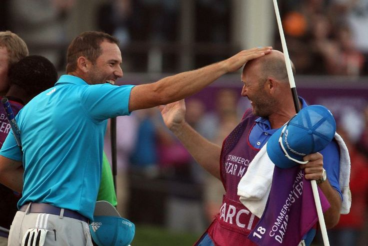 Sergio Garcia of Spain,Left, celebrates after his eagle putt on the 18th green during the final round of the Commercial Bank Qatar Masters a...