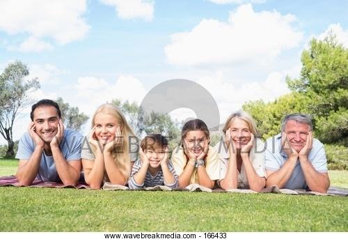 family posing together Image by Wavebreak Media