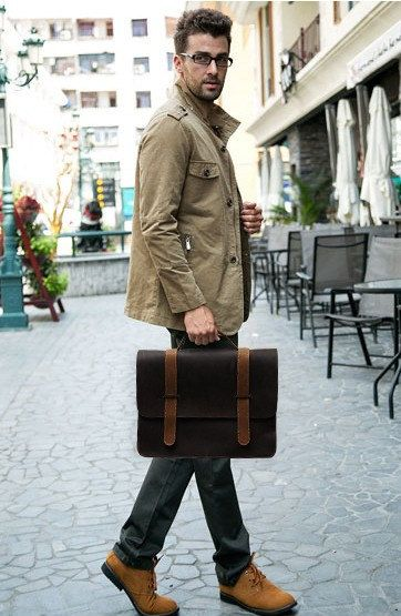 34CM*24C*10CM Material: leather Color: dark brown  Weight:1.7kg