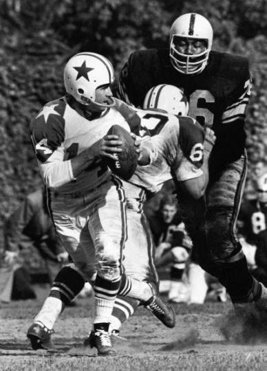 "The Dallas Cowboys against the Pittsburgh Steelers in Dallas, 1962. The Dallas QB is Eddie LeBaron. The monster Pittsburg defensive lineman is Gene ""Big Daddy"" Lipscomb, the prototype for the modern NFL lineman at 6'6"", 300 .lbs. He would die of a heroin overdose within the year. He was most famous for saying, ""I just wrap my arms around the whole backfield and peel 'em one by one until I get to the ball carrier. Him I keep."""