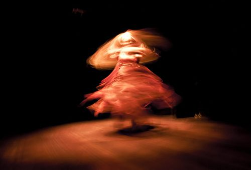 This is an example of implied movement, via slow-shutter photography. This is a still, single image without movement that is still creating the illusion of movement.