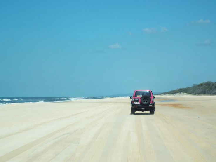 Convoy of Pink 4x4s on Fraser Island's 75-mile beach! Check out my blog post on exploring Fraser Island by 4WD Tag Along Tour! It was the most amazing experience! #fraserIsland #australia #travelaustralia #eastcoastaustralia #travelblogger #travel #travelreview